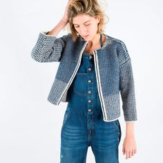 Our new wardrobe staple, Cardigan No.4 explores a type of knitwear that brings its structure closer to weave. Crafted from tactile Spanish cotton