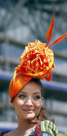 royal ascot - a rather unusual hat but I love the color, it's not too big for the woman wearing it, and not too fussy - I think I rather like it