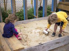 Children play in the sandbox