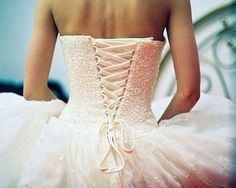i LOVE this back! always wanted to have a lace up back on my wedding dress :)