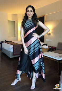 Beautiful Satin Kurti with asymmetric stripes placement. Kurti Neck Designs, Kurta Designs Women, Kurti Designs Party Wear, Western Dresses For Women, Stylish Dresses For Girls, Casual Dresses, Indian Fashion Dresses, Dress Indian Style, Fashion Outfits