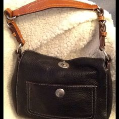 Coach leather handbag Coach durable and timeless in brown leather with hot pink satin interior. Brand new condition! Rarely worn <3. Height 7 1/2 inches, length 9 inches and width 31/4 inches. 2 interior pockets and 1 exterior pocket. As is. Coach Bags
