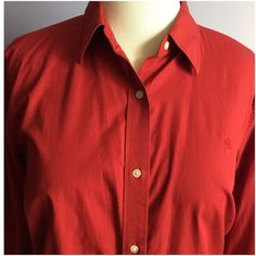 """Ralph Lauren Red Button Down Shirt Classic Red Button down by Ralph Lauren. Has darts for ease of fit through bust line. Tonal RL logo on left chest. 100% cotton 27"""" from shoulder to hem, 25"""" across bust. Ralph Lauren Tops Button Down Shirts"""
