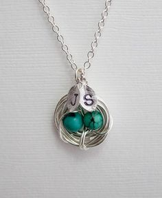 Personalized Jewelry Turquoise Nest Silver Necklace, 2 Initials and Two Eggs, Perfect Gift for Mom or a baby shower present. $28.50, via Etsy. (i own 3 necklaces by this business and they all are beautifully crafted)