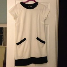 """75% off!! NWT laundry ivory/black dress Great dress! Per tag, machine wash warm; 74% polyester and 26% rayon.  Has 2 pockets in the front   I'm 5'5"""" and it falls around my knees. It does not have another later underneath. NWT! Laundry by Shelli Segal Dresses"""