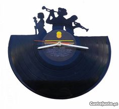 http://static2.custojusto.pt/mi/full/1352699286-relogio-de-parede-jazz-3-musicos-disco-vinil.jpg