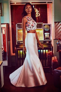 A floral embroidered crop top prom dress hits all of this years most popular trends. Shop this look and more at David's Bridal