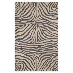 Hand-tufted zebra-print rug.  Product: RugConstruction Material: Polypropylene and acrylicColor: Black and tanFeatures: Handmade Note: Please be aware that actual colors may vary from those shown on your screen. Accent rugs may also not show the entire pattern that the corresponding area rugs have.