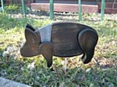 "This handmade Little Pig Yard Stake has a rusty star on his head.  He is full of character and sure to bring many smiles to your home!    He is put together with screws, he has been handpainted, sanded and treated for outdoor weather.    This little pig comes with a pointed wood dowel rod that can be attached to stick down in the ground.  You may choose to place him on a shelf without the dowel rod.    Measures 13"" L and stands 7"" H"