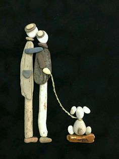 Driftwood and stone couple and dog art
