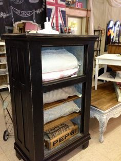 add and stain or paint added shelves to match, add vintage bottle crate for storing smalls.