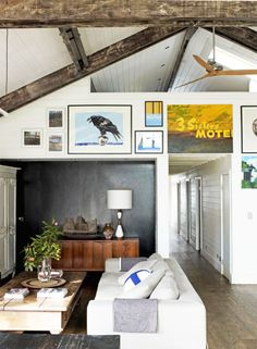 Love the raw exposed beams & dark wall.