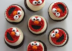 Elmo cupcakes: standard with Elmo cookie topper. I need to make these for Emily!