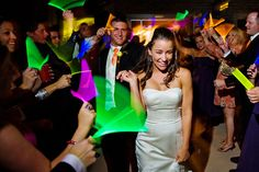 A wedding reception glow stick run is a great way to end the night!