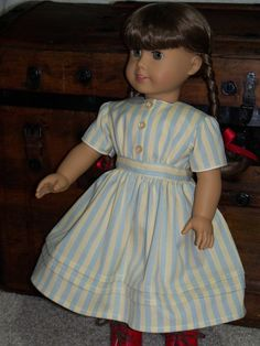Ive made this dress specially for the American Girl Kirtsen doll, using light blue and pale yellow striped cotton, taking great care with little details such as tucks and top stitching. Sleeves are piped with ivory cotton. Tiny pearl buttons accent the front. The back closes with Velcro. Perfect for children, collectors or any doll lover!  ****Doll dress ONLY is for sale.  https://www.etsy.com/shop/thirdsisterhandmade  Need a birthday card to give with this gift?  https:&#...