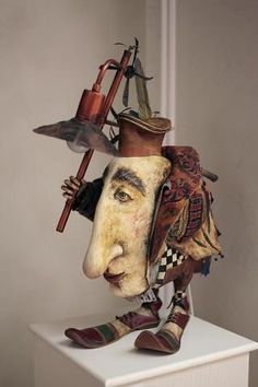 guessing James Christensen: if not his work, greatly influenced byGreat sculpture - I see the face of actor Judd Hirsch in him.Frederick had all the makings of a rip-roaring Renaissance Man.This quirky piece is really charming to me, I love the char Toy Art, Collage Kunst, Drawn Art, Unusual Art, Paperclay, Assemblage Art, Whimsical Art, Ceramic Art, Altered Art