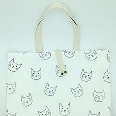 A Meow fold-up shopper for a Meow lover 🐈 My shoppers are hand block printed, fully lined, have a triple stitched base and a pair of… Folded Up, Fabric Design, Wolf, Base, Pairs, Stitch, Printed, Grey, Instagram