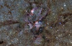 This infrared image, released by the ESO on Feb. 20, 2013, shows stellar nursery NGC 6357, also called the Lobster Nebula. The image, taken from ESO's VISTA telescope, reveals vast, glowing clouds of gas and dust surrounding hot young stars