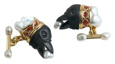 A pair of gold, enamel and pearl cufflinks by Otto Jakob portraying raven's heads on clouds.