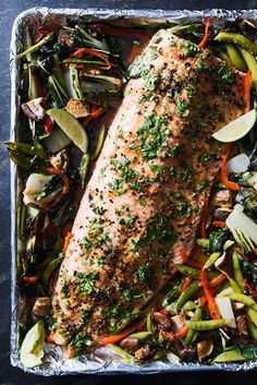 Watch and learn how to make a soy-glazed whole fillet of salmon with roasted vegetables.