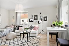Interior for small studio apartment. The key is the large rug