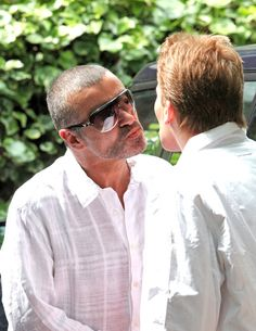 George Michael Photos Photos - George Michael celebrates his 47th birthday with his husband Kenny Goss and close friend Geri Halliwell, along with her daughter Bluebell Madonna (b. May 14, 2006) at the Red Lion & Sun Pub.  George looked skinny and in great spirits as he left holding a children's DVD. - George Michael at the Red Lion & Sun Pub