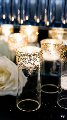 Add a touch of Art Decp gold to your wedding with these easy DIY glitter candle holders! See the tutorial here: http://blog.weddingstar.com/diy-wedding-decor-ideas-a-touch-of-art-deco-gold/