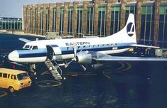 """Eastern Air Lines Convair Metropolitan at New York-JFK, July Experimental livery, prior to the adoption of the similar """"Hockey Stick""""scheme later the same year. (Photo: Courtesy of Michael Anthony) Miami Houses, Vintage Airline, Air Lines, Commercial Aircraft, Civil Aviation, Jfk, Alaska, Planes, Hockey"""