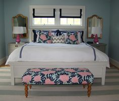 Fresh! White, navy, turquoise and pink bedroom with a white bed frame, bedroom bench and matching white bedside tables.