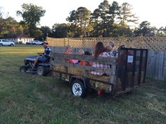 A hayride with the riding lawnmower hooked up to a trailer with hey in it!! Great for Halloween or cowboy party