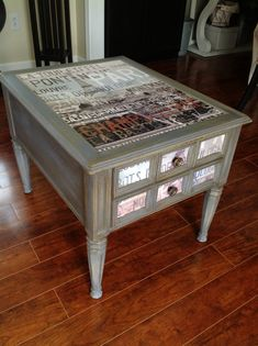 My Goodwill Table Upcycle. For $25 I purchased this table, and transformed it into a gorgeous, vintage-looking piece with a Paris posterboard, Mod Podge'd.