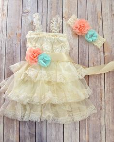 Beautiful little girls special occasion dress. Made of antique-looking ivory lace, has an embellished sash that includes coral and mint