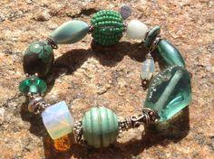 verdigrisgal ~ fine sterling...genuine peacock turquoise...vintage glass...tumbled beachglass...asian moonstone...genuine wood...handwoven seedbead sphere...art glass...aurora borealis glass...turquoise heshi...raku porcelain www.boobybrain.com