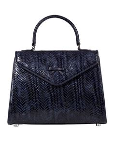 ANN THE BELGIAN BAG from Hayden Lasher features navy blue viper embossed leather with navy blue lambskin piping, signature bow detail, and nickel hardware.