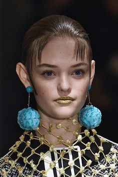 Prada: We love the drop earring trend happening for spring, but we love it even more on the characters who wear them best.