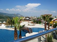 Soak up the sun in Kusadasi Aydin by this stunning pool Investment Property, Property For Sale, Mountain View Apartment, Kusadasi, Apartments For Sale, Stunning View, Resort Spa, Sun Lounger, Terrace