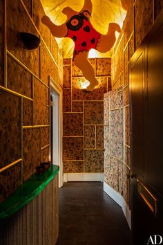 Niki de Saint Phalle's Inflatable Nana greets visitors in the cork-lined entrance hall, which is an homage to Marcel Proust   archdigest.com