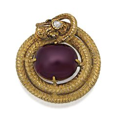DIAMOND AND GARNET BROOCH, CIRCA 1850  The oval shaped carbuncle claw set and encircled by a coiled serpent, its textured body decorated with scale engraving, inset to the head with a pear shaped diamond accented with rose cut diamond set eyes, mounted in 15ct gold