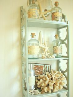 shell shocked - Fun assortment of shell decor bathroom. Existing shelf painted.