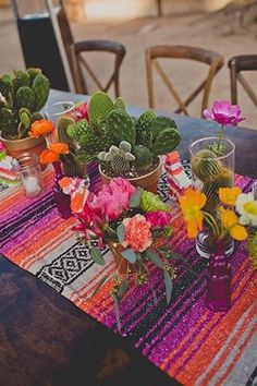 Bright Southwest table runner with colorful cactus wedding centerpieces.