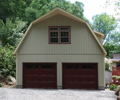 24' x 24' Elite Dutch Garage with T-1-11 siding, Carriage style overhead doors with Stockbridge glass, Roof extension, Custom dormers, Window & door upgrades, Extra windows and doors, Transom windows, Flower boxes and Cupola.
