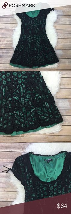 "Vintage 90s Betsey Johnson Crochet Lace Dress Good condition Vintage 90's Betsey Johnson Crochet Lace Dress. Size 4. Emerald lining covered in Crochet black lace. Cap sleeves with bows. Invisible side zipper. Fit and Flare. Shell is cotton & silk, fully lined in polyester. Bust 34"", waist 28"", hips 38"", length 34.5"". No trades, offers welcome. Betsey Johnson Dresses"