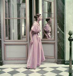 Model wearing a Balenciaga evening gown at Versailles in a 1952 photo by Frances McLaughlin-Gill for Vogue