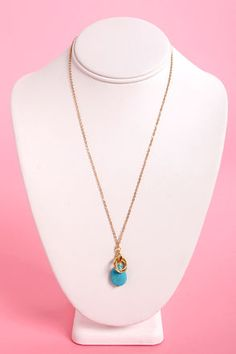 Check it out from Lulus.com! Ladies and gentleman! Tonight promises a series of amazing events, but first let us introduce you to the Three Ring Circlets Blue Pendant Necklace! A lovely teardrop-shaped pendant in turquoise blue is topped by three golden circlets on a thin gold chain. Pendant measure .75