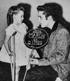 have always assumed that only one photo existed of Joanne giving Elvis a kiss. But here you see them sharing the lollipop.