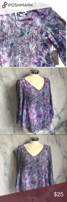 NWT Jennifer Lopez Purple Blouse Vneck 3/4 sleeve top, flowy fit. Layered material that splits in back, flyaway style. Keyhole with crystal button on back. Comes with extra button. Flowy sleeve. Purples, green animal print snake skin design. New with tags. Jennifer Lopez from Kohls, size small. Stock photo shows top in a different print. Jennifer Lopez Tops