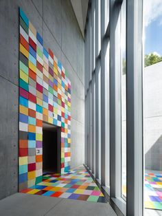 Hmmm. also for a new offices space. Dominant grays with celebrative contemporary patches of quilting/tiling. Nice.