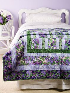 The Scent of Lilacs Quilt Pattern Download from e-PatternsCentral.com -- You can almost smell the lilacs in bloom on this pretty quilt pieced with easy strip blocks.