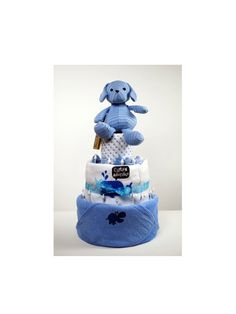 The perfect Christening or Baby Shower Gift!    This 3 Tier cake includes:    1x Blue Dog Plush (0+ years),  1x Hooded Baby Bath Towel,   1x Fleece blanket,  3x Feeding/ Muslin Cloths,   2x Pairs of Scratch Mits,  5x Pairs of socks,  5x Bibs  50x Size 1 Pampers Nappies,  Safety buds.