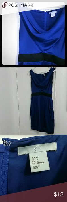 Silky blue dress Wide elastic waist, gorgeous royal blue. Looks nice with black tights, booties, and a cardi for work, but can definitely be dressed up too. Drape neck is very flattering.   Purchased at h&m. Worn, but good condition.  Oh, and pockets!!! H&M Dresses